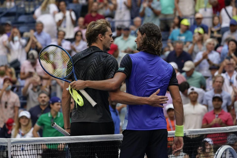 Alexander Zverev, of Germany, left, greets Lloyd Harris, of South Africa, at the net after defeating Harris during the quarterfinals of the US Open tennis championships, Wednesday, Sept. 8, 2021, in New York. (AP Photo/Elise Amendola)