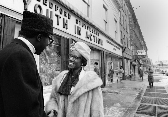 In this Dec. 20, 1968, photo, New York Assemblywoman Shirley Chisholm talks with a constituent in Brooklyn, New York. Chisholm's election to Congress was the start of a national political career in which she fearlessly and relentlessly stood up and spoke out for causes like civil and women's rights.