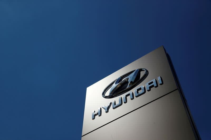 FILE PHOTO: A shop sign of Hyundai is seen outside a car showroom in Bletchley, Milton Keynes, Britain