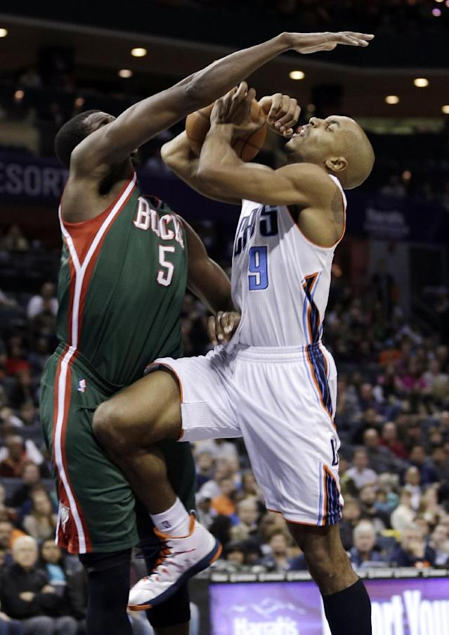 Charlotte Bobcats' Gerald Henderson (9) is fouled by Milwaukee Bucks' Ekpe Udoh (5) during the first half of an NBA basketball game in Charlotte, N.C., Friday, Nov. 29, 2013. (AP Photo/Chuck Burton)