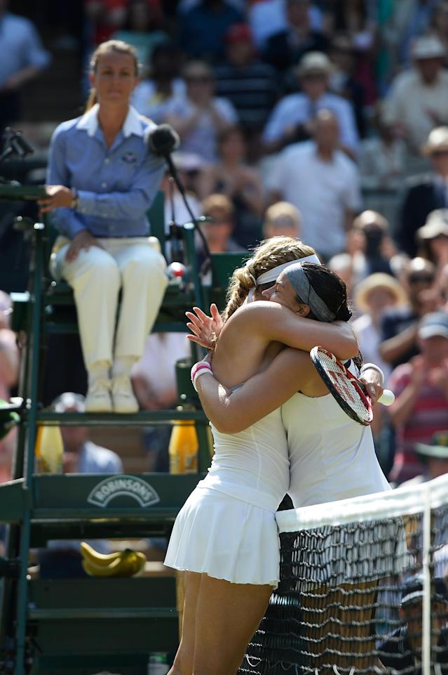 LONDON, ENGLAND - JULY 06: Marion Bartoli of France embraces Sabine Lisicki of Germany at the net after their Ladies' Singles final match on day twelve of the Wimbledon Lawn Tennis Championships at the All England Lawn Tennis and Croquet Club on July 6, 2013 in London, England. (Photo by Dennis Grombkowski/Getty Images)