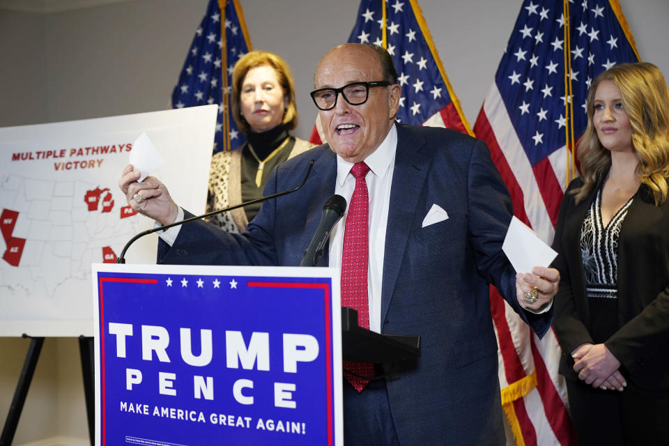 FILE - In this Nov. 19, 2020 file photo, former Mayor of New York Rudy Giuliani, a lawyer for President Donald Trump, speaks during a news conference at the Republican National Committee headquarters in Washington. After suggesting that his expiring mayoral term be extended due to the 9/11 emergency -- an idea that was roundly dismissed -- Giuliani went into private life, but not all that private. He launched a profitable security firm and ran abortively for the Republican nomination for president in 2008. His adventures as a supporter of and agent for Trump are well documented, and resulted in the suspension of his law license in his home state. (AP Photo/Jacquelyn Martin, File)