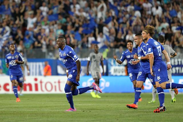 Bastia's French midfielder Christopher Maboulou (L) celebrates after scoring a goal during their French L1 football match against Marseille, on August 9, 2014 in Bastia (AFP Photo/Pascal Pochard-Casabianca)