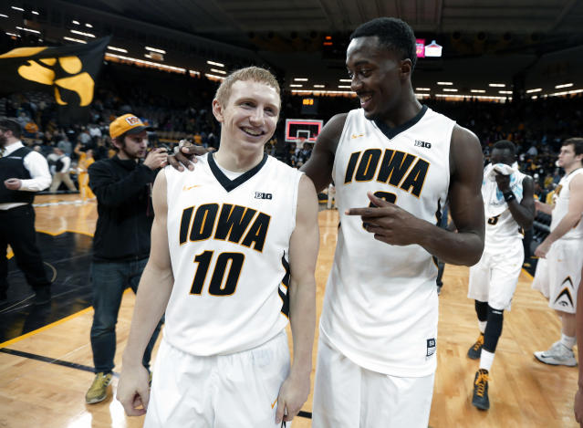 Iowa's Mike Gesell, left, and Gabriel Olaseni walk off the court after their 86-55 victory over Penn in an NCAA college basketball game, Friday, Nov. 22, 2013, in Iowa City, Iowa. (AP Photo/Charlie Neibergall)