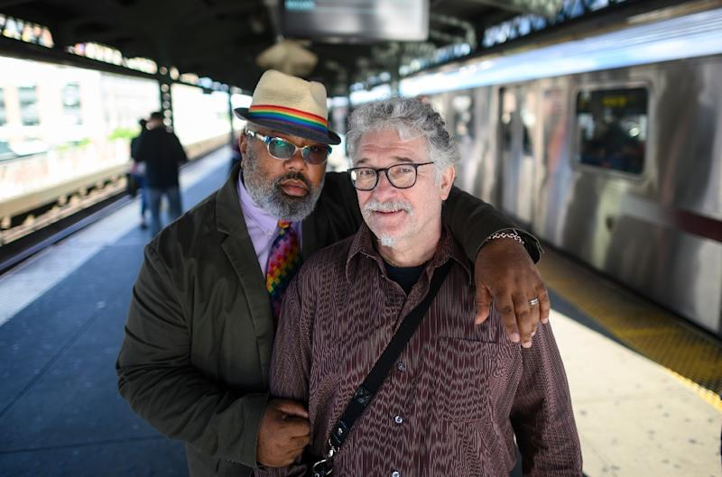 Stanley Reed (L) and husband Oliver Hummel (R) pose in New York -- they say while a lot of progress has been made since the Stonewall uprising, prejudice still remains (AFP Photo/Johannes EISELE)