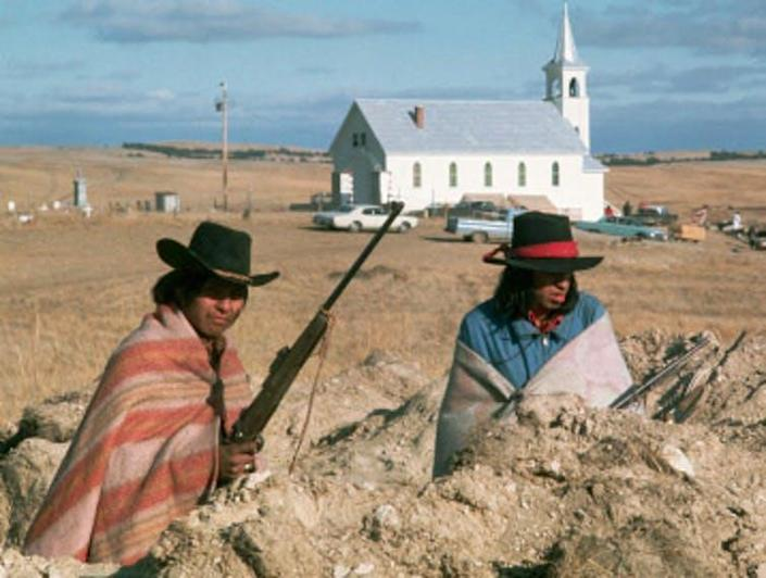 """<span class=""""caption"""">Wounded Knee protest in 1973.</span> <span class=""""attribution""""><span class=""""source"""">Still from PBS documentary.</span></span>"""
