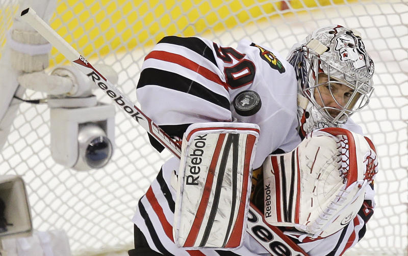 Chicago Blackhawks goalie Corey Crawford blocks a shot by the Los Angeles Kings during the third period of Game 3 of the NHL hockey Stanley Cup playoffs Western Conference finals, Tuesday, June 4, 2013, in Los Angeles. (AP Photo/Jae C. Hong)