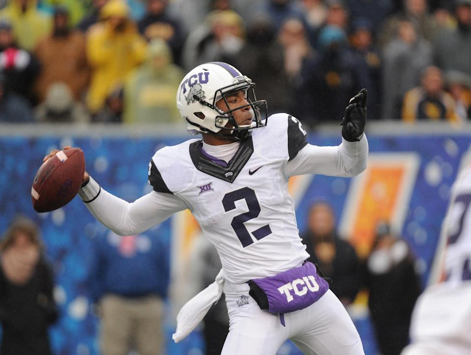 TCU's Trevone Boykin (2) passes during the second quarter of an NCAA college football game against West Virginia in Morgantown, W.Va., Saturday, Nov. 1, 2014. (AP Phpto/Tyler Evert)