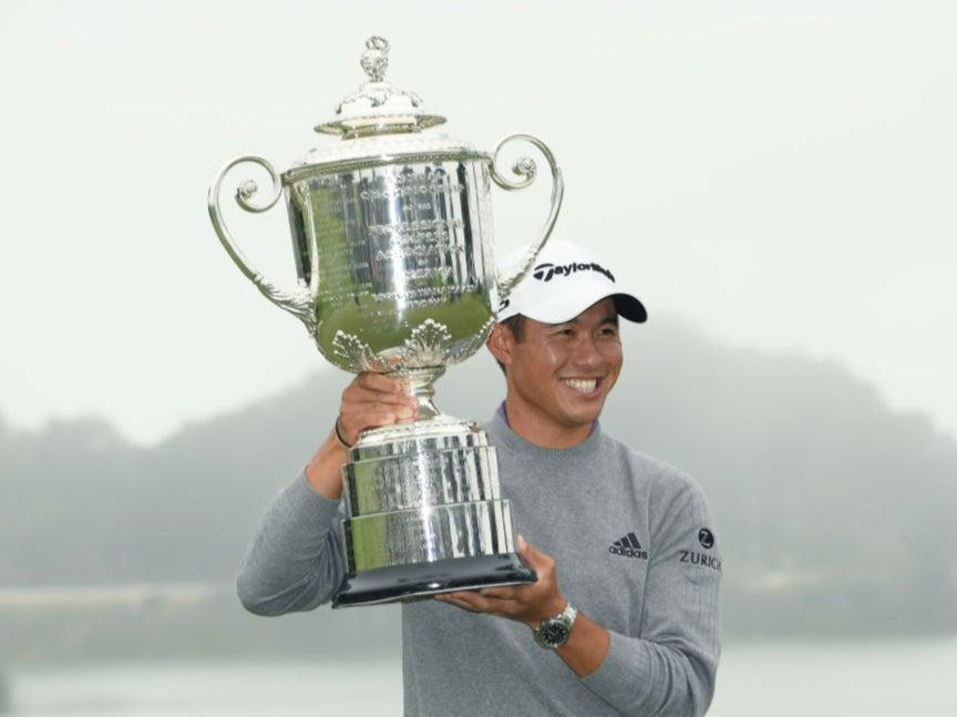Collin Morikawa celebrates with the Wanamaker Trophy (Getty Images)