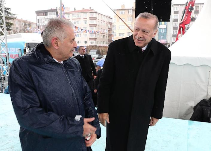 Turkish President Recep Tayyip Erdogan (R) selected former premier Binali Yildirim (L) as the AKP's Istanbul mayoral candidate in local elections (AFP Photo/Handout)