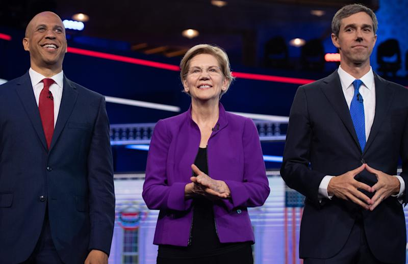 Warren with fellow candidates Sen. Cory Booker (N.J.), left, and former Rep. Beto O'Rourke (Texas) at the first Democratic Party presidential primary debate. (Photo: SAUL LOEB via Getty Images)