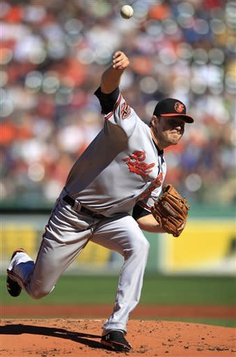 Baltimore Orioles starting pitcher Chris Tillman delivers a pitch against the Boston Red Sox in the first inning of a baseball game at Fenway Park, in Boston, Sunday, Sept. 23, 2012. (AP Photo/Steven Senne)