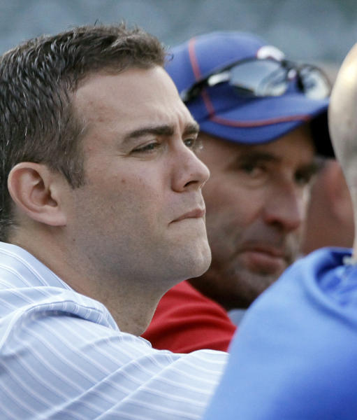 FILE - In this Aug. 28, 2012, file photo, Chicago Cubs president of baseball operations Theo Epstein, left, watches batting practice with manager Dale Sveum before a game against the Milwaukee Brewers in Chicago. Even for a team with a record of futility unmatched in professional baseball and, heck, all of professional sports, this season has been one of the most dismal in Cubs history. About the only good thing that could be said about a team poised to lose 100 games for the first time in 46 years--one of which came after the shortstop trotted off the field thinking there were three outs instead of two--is that it is doing so in front of fewer fans than any year in the last decade. (AP Photo/Charlie Arbogast, File
