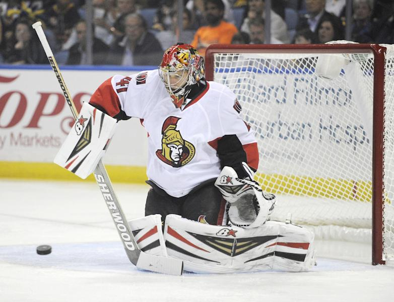 Ottawa Senators goalie Craig Anderson (41) follows the puck during the first period of a NHL hockey game against the Buffalo Sabres in Buffalo, N.Y., Friday, Oct. 4, 2013. (AP Photo/Gary Wiepert)