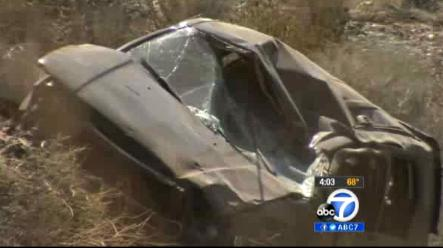 This video frame curtesy KABC TV Los Angeles shows a crash of an SUV in Action, Calif. on Sunday, March 24, 2013. A 9-year-old girl crawled out of the mangled SUV, climbed out of a canyon and walked about a mile in the middle of the night to find help after surviving the highway crash that killed her father in Southern California, authorities said. (AP Photo/KABC TV) (AP Photo/KABC TV)