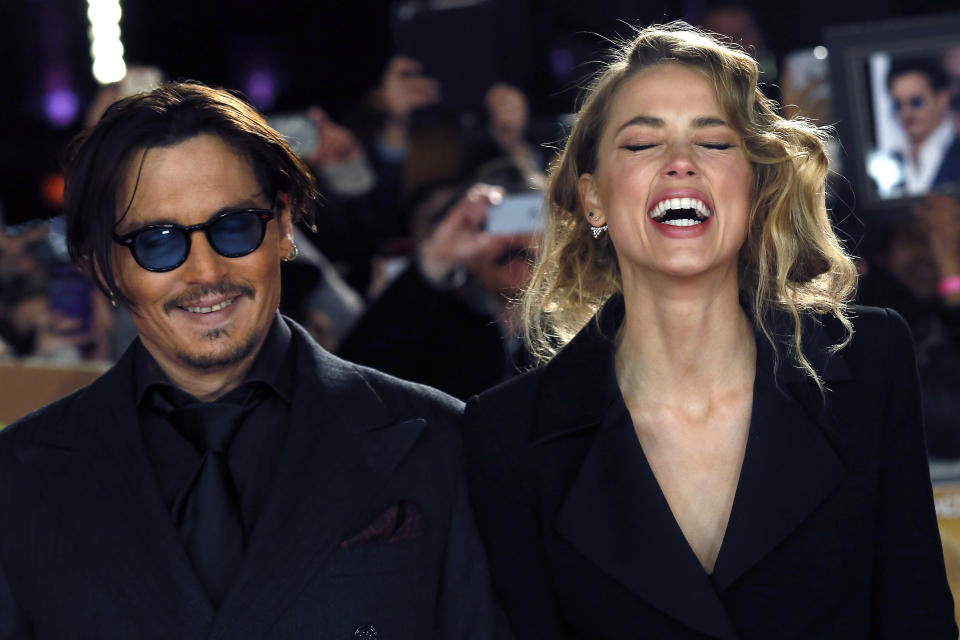 """Actor Johnny Depp and girlfriend Amber Heard laugh as they arrive for the UK premiere of """"Mortdecai"""" at Leicester Sqaure in London January 19, 2015.  REUTERS/Luke MacGregor  (BRITAIN - Tags: ENTERTAINMENT)"""