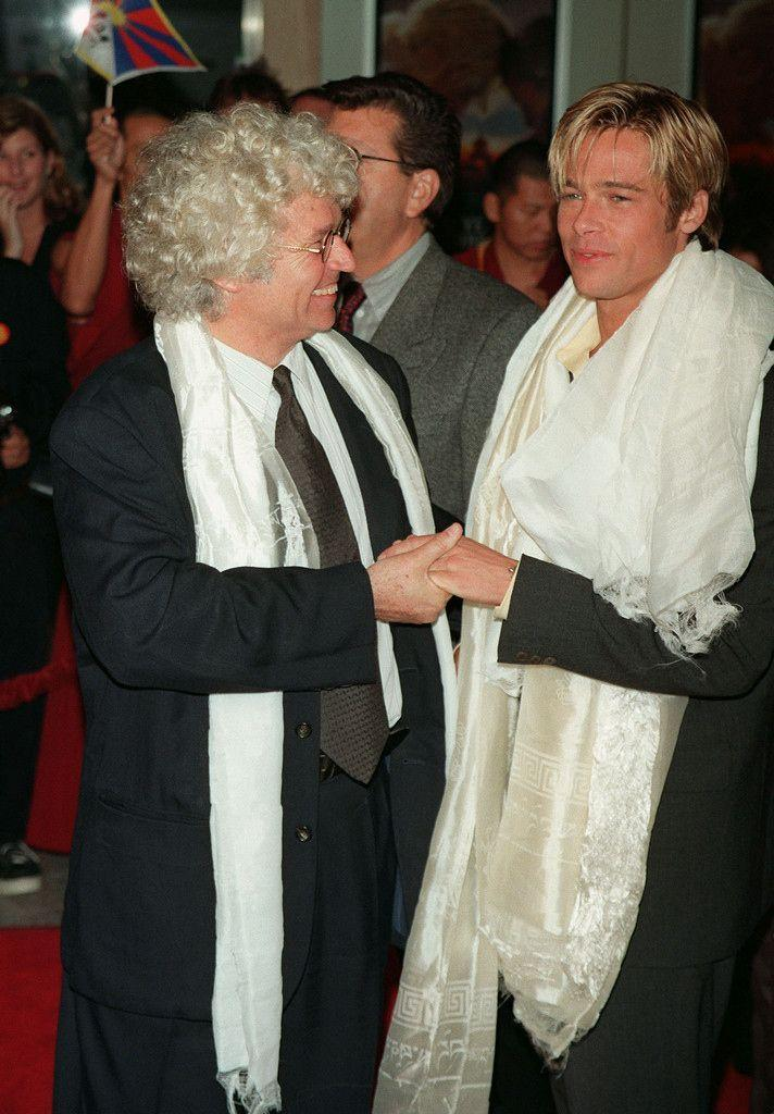 """<p>Pitt and director Jean-Jacques Annaud pose at the premiere of <em>Seven Years in Tibet</em>. The film's portrayal of the Chinese government resulted in Annaud and Pitt being banned from China after its release, but the <a href=""""https://www.thestar.com/news/world/2016/11/14/brad-pitt-back-in-china-nearly-20-years-after-reported-ban-over-tibet-film.html"""" rel=""""nofollow noopener"""" target=""""_blank"""" data-ylk=""""slk:Associated Press"""" class=""""link rapid-noclick-resp"""">Associated Press</a> reports that Pitt returned in 2014 with then-wife Angelina Jolie.</p>"""