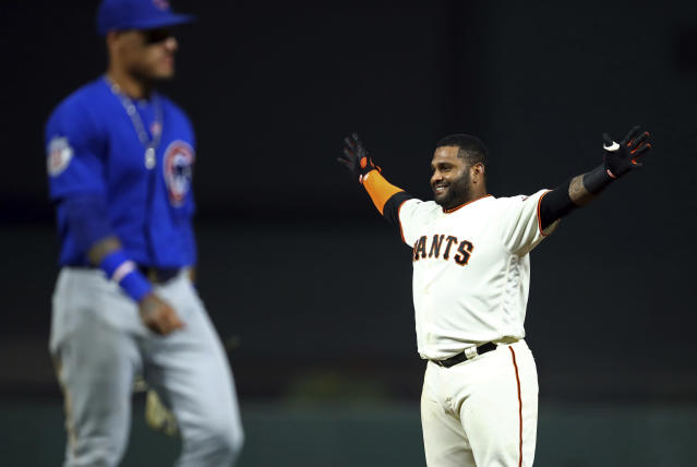 San Francisco Giants' Pablo Sandoval, right, celebrates in front of Chicago Cubs' Javier Baez after making the game-winning hit in the 11th inning of a baseball game, Monday, July 9, 2018, in San Francisco. The Giants won 2-1. (AP Photo/Ben Margot)