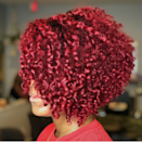"""<p>Intense reds like this one created by <a href=""""https://www.instagram.com/qfutrellhair/"""" rel=""""nofollow noopener"""" target=""""_blank"""" data-ylk=""""slk:DC-based Stylist Quarita Futrell"""" class=""""link rapid-noclick-resp"""">DC-based Stylist Quarita Futrell</a> means that at-home upkeep is super-important. To keep things vibrant, consider an equally-as-intense moisture cream treatment to restore any shine broken down during the dyeing process.</p>"""