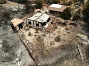 This aerial view shows a burned house in the village on the southern slopes of the Troodos mountains