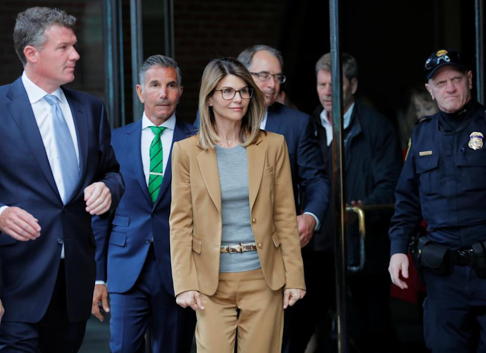 Actor Lori Laughlin, and husband, fashion designer Mosimo Giannulli, (C) are facing charges in a nationwide college admissions scheme, leaving federal court in Boston, Massachusetts, US, April 3, 2019.  REUTER / Brian Snyder