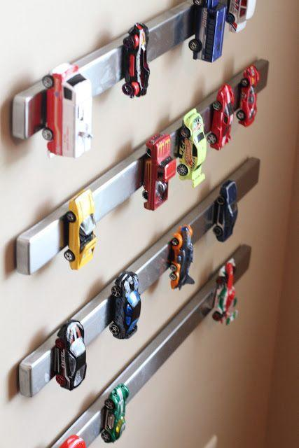 """<p>This is one of those genius ideas we wish we thought of first. Here, metal toy cars find a new parking spot on a magnetic knife holder. Clever, right?</p><p><a href=""""http://www.keepingupwiththesouths.com/2012/10/pinterest-project-just-hangin-around.html"""" rel=""""nofollow noopener"""" target=""""_blank"""" data-ylk=""""slk:See more at Keeping Up With The Souths »"""" class=""""link rapid-noclick-resp""""><em>See more at Keeping Up With The Souths »</em></a></p>"""