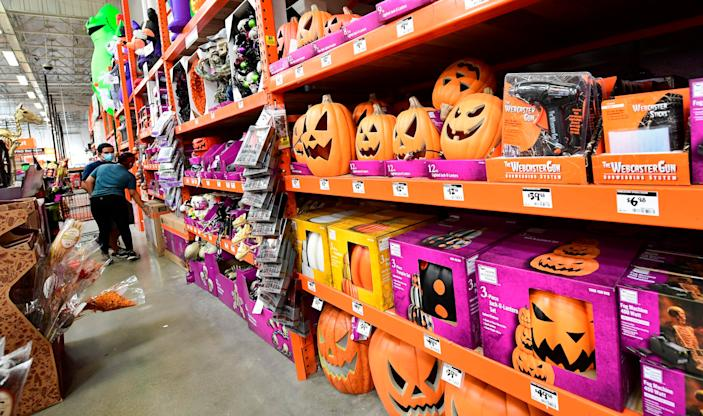 Shoppers peruse the Halloween assortment at a home improvement store in Alhambra, Calif. on Sept. 9, 2020.