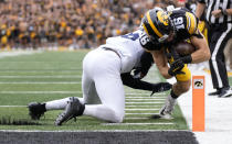 Iowa wide receiver Charlie Jones (16) dives in for a touchdown despited defensive efforts by Penn State safety Ji'Ayir Brown (16) during the first half of an NCAA college football game, Saturday, Oct. 9, 2021, in Iowa City, Iowa. (AP Photo/Matthew Putney)