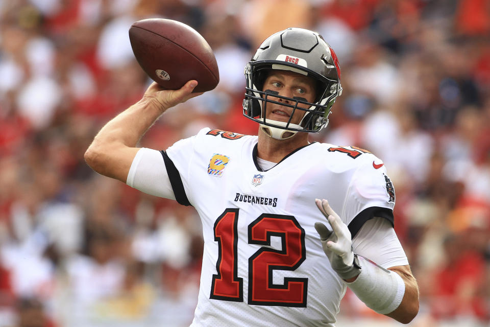 TAMPA, FLORIDA - OCTOBER 24: Tom Brady #12 of the Tampa Bay Buccaneers throws a pass in the first quarter against the Chicago Bears in the game at Raymond James Stadium on October 24, 2021 in Tampa, Florida. (Photo by Mike Ehrmann/Getty Images)