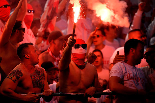 <p>Cologne supporters ignite pyrotechnics during the German Bundesliga soccer match between Bayer 04 Leverkusen and 1. FC Cologne in Leverkusen, Germany, May 13, 2017. (Photo: Sascha Steinbach/EPA) </p>