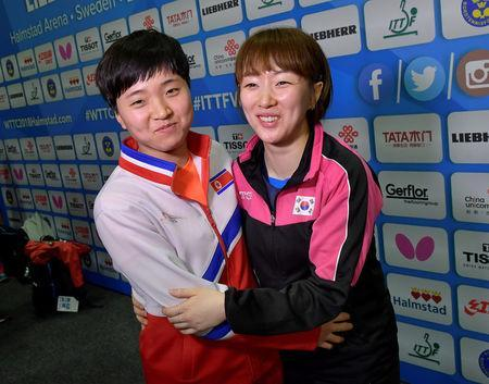 Suh Hyo-Won of South Korea and Kim Song I of North Korea react after a news conference, in Halmstad, Sweden May 3, 2018. TT News Agency/Jonas Ekstromer/via REUTERS