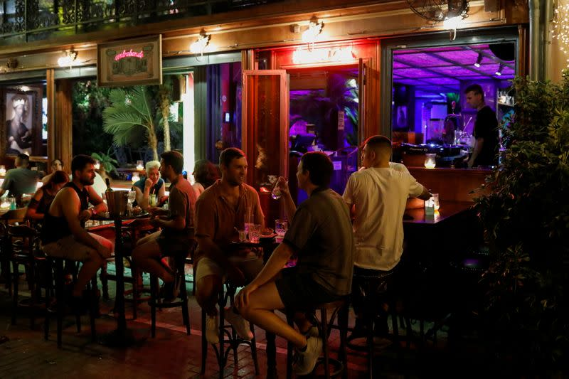 People sit at a bar, amid the spread of the coronavirus disease (COVID-19), in Athens