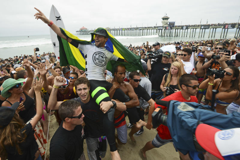 Alejo Muniz, of Brazil, was crowned the men's champion of the 2013 Vans US Open of Surfing competiont after defeating local surfer Kolohe Andino in the men's final on Sunday, July 28, 2013, in Huntington Beach, Calif. (AP Photo/The Orange County Register, Kevin Lara) MAGS OUT; LOS ANGELES TIMES OUT.