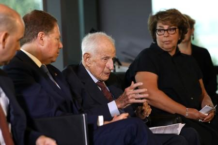 FILE PHOTO:  Sylvie Sulitzer listens as former U.S. Attorney Robert Morris Morgenthau speaks during ceremony to return painting by Pierre Auguste Renoir, stolen by Nazis in World War II in New York