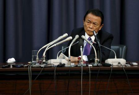 Japan's Finance Minister Taro Aso attends a news conference at the Finance Ministry in Tokyo