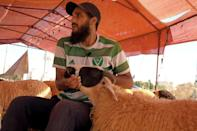 Sheep seller Osama al-Aqury blames soaring fodder prices for the rising cost of meat in Libya