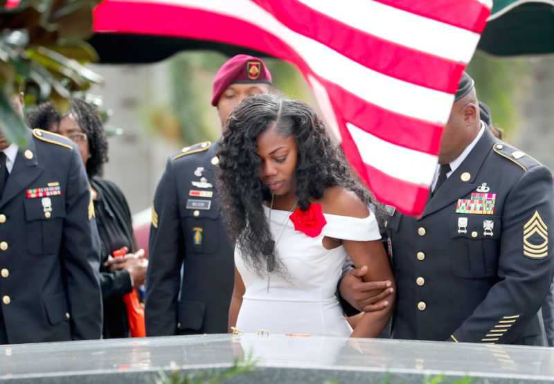 Myeshia Johnson looks down at the coffin of her husband, David (Picture: Rex)