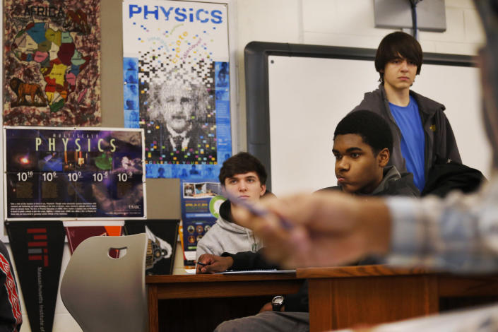 From left to right: students James Agostino, 12th grade; Columbus McKinney, 12th grade; Nick Girdis, 11th grade; listen during their Advanced Placement (AP) Physics class at Woodrow Wilson High School in Washington, Friday, Feb. 7, 2014. The College Board says in a new report that the number of U.S. public students taking Advanced Placement classes doubled over the last decade. The class of 2013 of took 3.2 million AP exams. (AP Photo/Charles Dharapak)