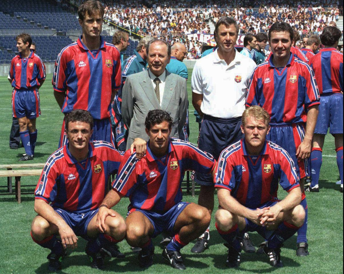 F.C. Barcelona's President Josep Luis Nunez, back second left, and Dutch coach Johan Cruyff, back second right, pose with the team's new players during the presentation of the team in Barcelona Wednesday July 26 1995. They are back left to right, Bosnian Meho Kodro and Romanian Gheorghe Hagi, who signed on last year. Front left to right, Romanian Gheorghe Popescu, Portuguese Luis Figo and German Robert Prosinecki. (AP Photo/Cesar Rangel)