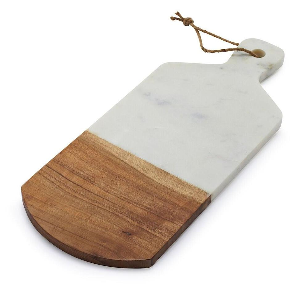 """<br><br><strong>Sur La Table</strong> Marble and Wood Serving Paddle, $, available at <a href=""""https://go.skimresources.com/?id=30283X879131&url=https%3A%2F%2Fwww.surlatable.com%2Fmarble-and-acacia-wood-cheese-serving-paddle%2F1603760.html"""" rel=""""nofollow noopener"""" target=""""_blank"""" data-ylk=""""slk:Sur La Table"""" class=""""link rapid-noclick-resp"""">Sur La Table</a>"""