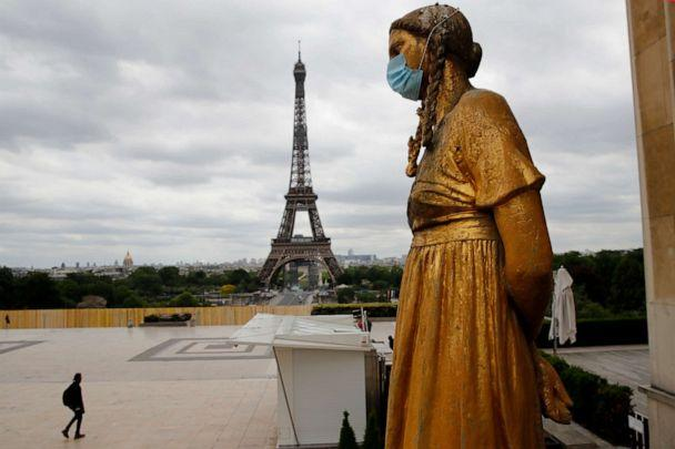 PHOTO: In this file photo dated May 4, 2020, a statue wears a mask along Trocadero square close to the Eiffel Tower in Paris, France. (Christophe Ena/AP)
