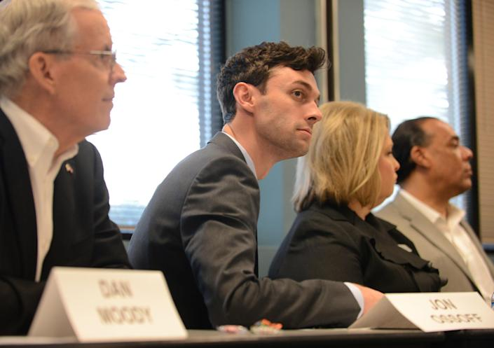 Democrat Jon Ossoff listens to other candidates speak during the League of Women Voters' candidate forum for Georgia's 6th Congressional District special election to replace Tom Price, who is now the secretary of Health and Human Services, in Marietta, Georgia, U.S. April 3, 2017. Picture taken April 3, 2017. REUTERS/Bita Honarvar