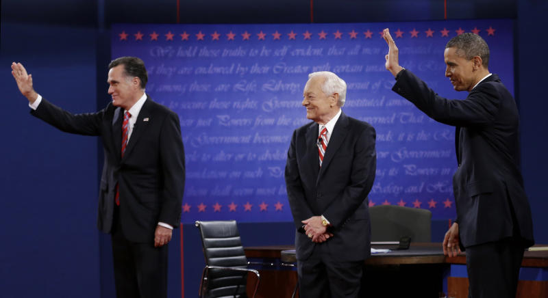Moderator Bob Schieffer, center, watches as Republican presidential nominee Mitt Romney, left and President Barack Obama  wave to members of the audience during the third presidential debate at Lynn University, Monday, Oct. 22, 2012, in Boca Raton, Fla. (AP Photo/Eric Gay)