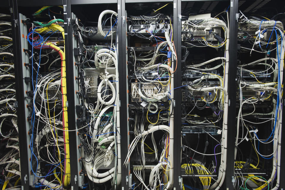 Data center equipment: server racks and jumbles of ethernet cables