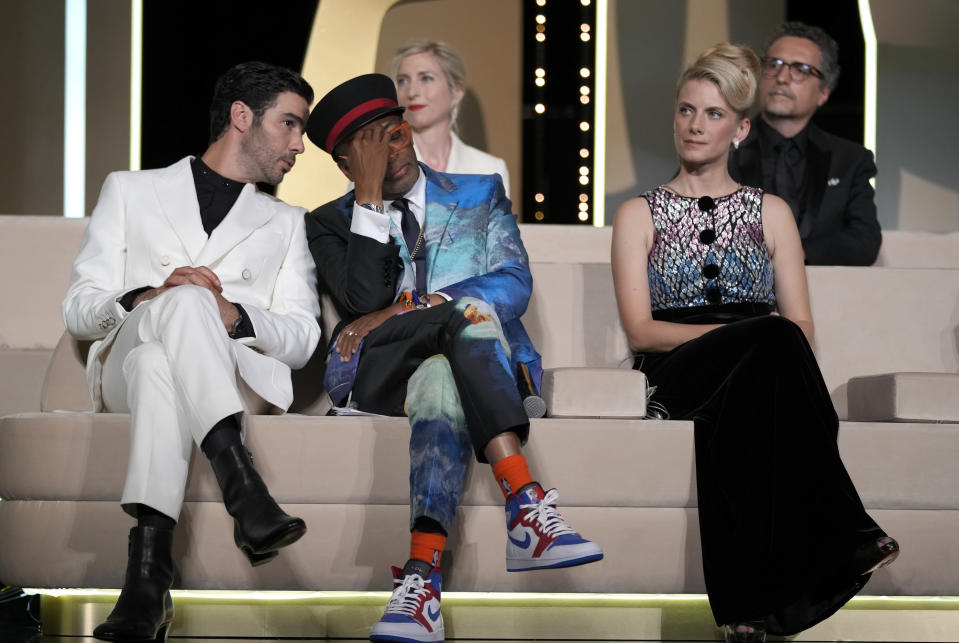 Jury president Spike Lee, center, holds his head in hands after accidentally revealing the film 'Titane' as the winner of the Palme d'Or as jury members Tahar Rahim, left, Jessica Hausner, back center, and Melanie Laurent look on during the awards ceremony at the 74th international film festival, Cannes, southern France, Saturday, July 17, 2021. (AP Photo/Vadim Ghirda)