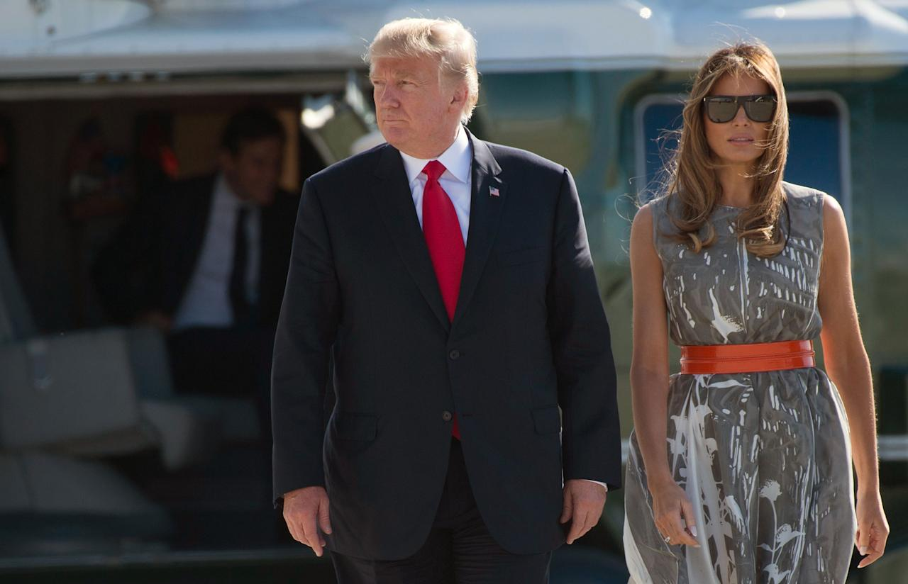 <p>President Donald Trump and First Lady Melania Trump make their way to board Airforce One after the G20 Summit in Hamburg, Germany, July 8, 2017. (Photo: Saul Loeb /AFP/Getty Images) </p>