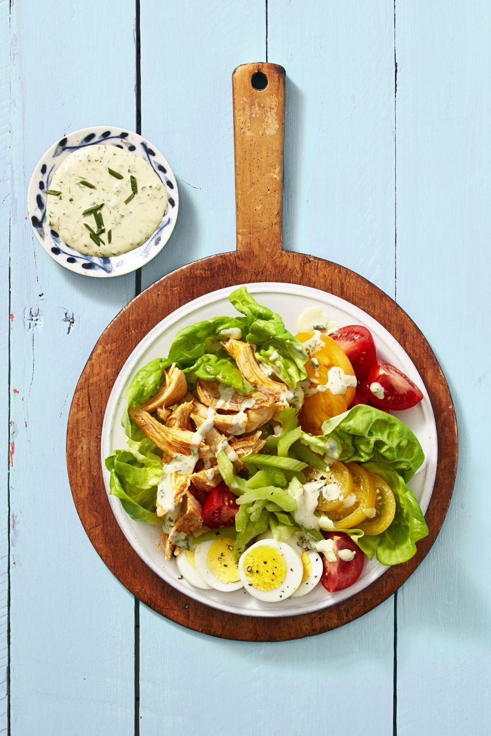 """<p>Consider serving hard-cooked eggs with a side of fiery buffalo chicken salad.</p><p><a href=""""https://www.goodhousekeeping.com/food-recipes/a39936/buffalo-chicken-cobb-salad-recipe/"""" rel=""""nofollow noopener"""" target=""""_blank"""" data-ylk=""""slk:Get the recipe for Buffalo Chicken Cobb Salad »"""" class=""""link rapid-noclick-resp""""><em>Get the recipe for Buffalo Chicken Cobb Salad »</em></a></p>"""