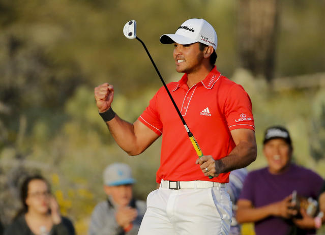 Jason Day, of Australia, celebrates on the 23rd hole after winning his championship match against Victor Dubuisson, of France, during the Match Play Championship golf tournament, Sunday, Feb. 23, 2014, in Marana, Ariz. (AP Photo/Matt York)