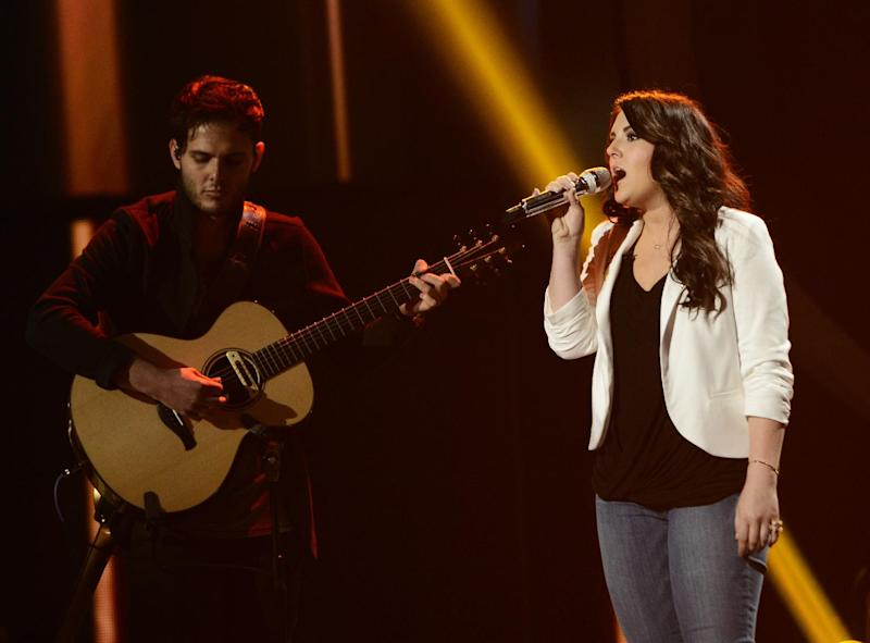 "This publicity photo released by Fox shows Kree Harrison, right, performing on ""American Idol,"" Wednesday, May 8 (8:00-10:00 PM ET/PT) on Fox. The current 12th season is set to conclude Thursday, May 16, 2013, with a showdown between the 23-year-old R&B vocalist Candice Glover of St. Helena Island, S.C., and the 22-year-old country crooner Harrison of Woodville, Texas. (AP Photo/Fox, Michael Becker)"