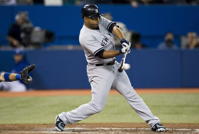 New York Yankees' Vernon Wells hits a single against the Toronto Blue Jays during the third inning of MLB American League baseball action in Toronto Wednesday, Sept. 18, 2013. (AP Photo/The Canadian Press, Mark Blinch)